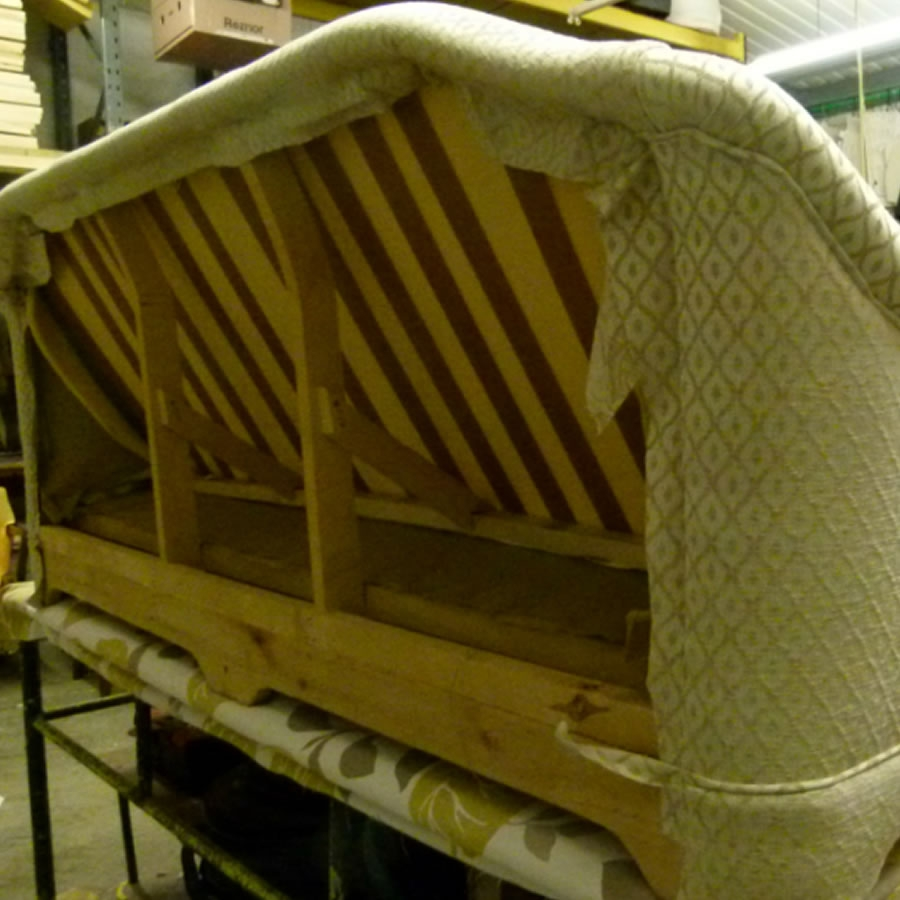 re-upholstery in progress in the New Wave workshop